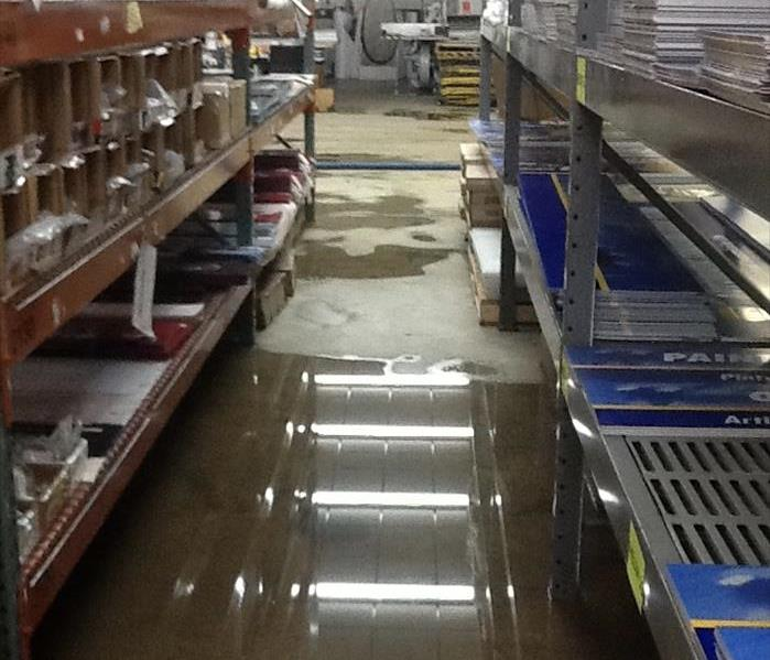 Water covered the aisle floors of this business