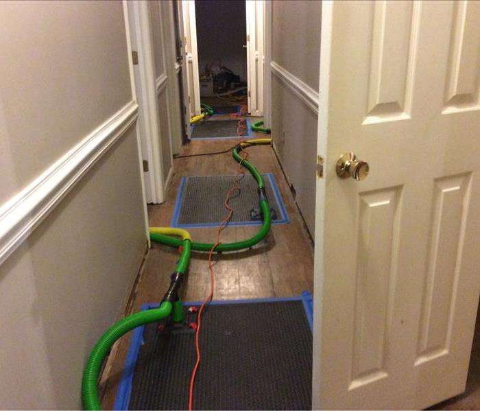floor mat drying system placed in hallway