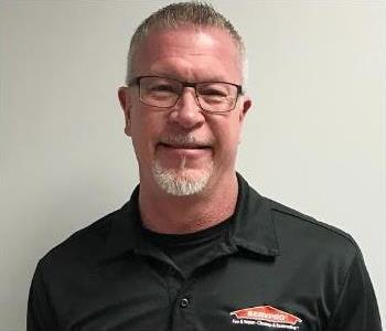 Head shot of male employee wearing SERVPRO shirt and glasses.